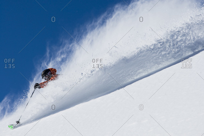 Bryce Philips skiing down on snowy landscape of Alta, Utah