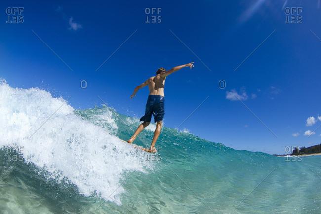 Lucas dirske bodysurfing at pupukea sandbar on the north shore of Oahu