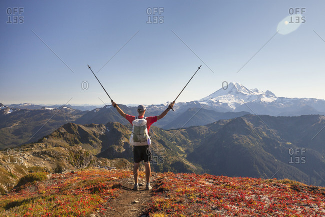 Backpacker exploring mount baker while hiking in north cascades national park