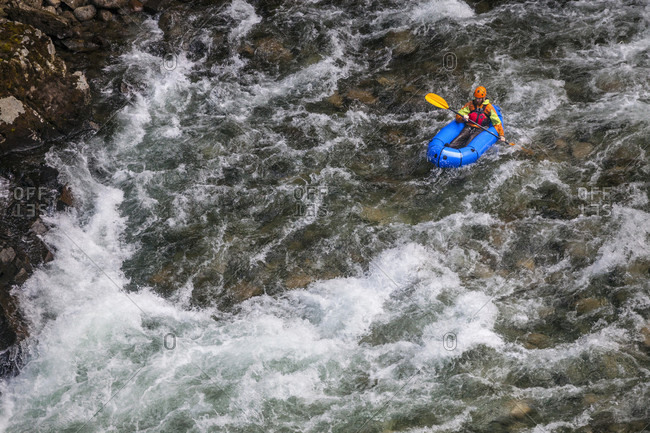 Evan Howard, an avid explorer and adventurer, navigates a white water section of the Chehalis river on a pack raft