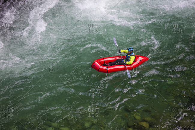 Adam palmer, mountain athlete, navigates a white water section of the Chehalis river on a pack raft