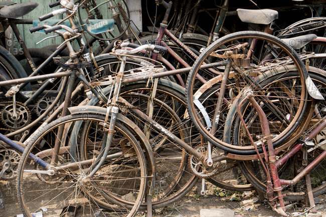Tamil Nadu, South India  - OCTOBER 18, 2016: Abundant rusty bicycles in a bike shop waiting to be repaired