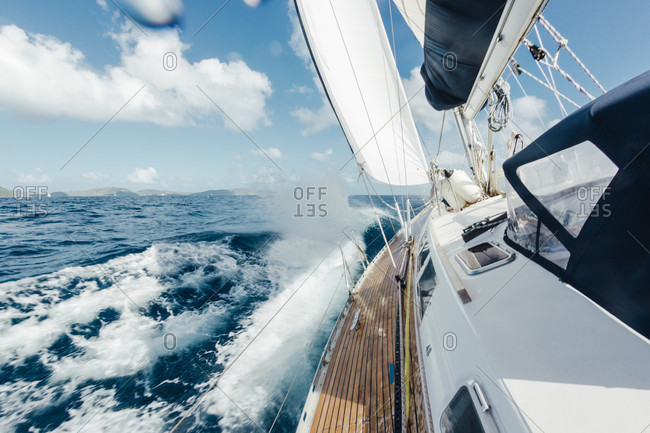 On board view of a boat sailing in rough seas in the Caribbean