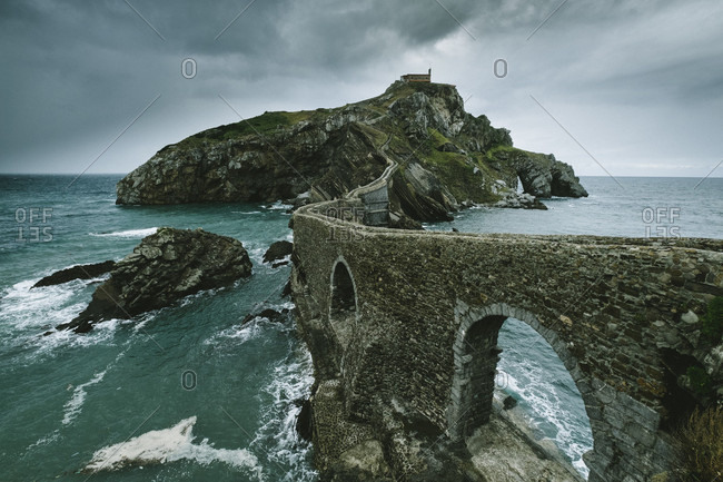 Islet of gaztelugatxe connected to the mainland by a man-made bridge