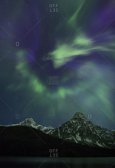 View of waterfowl lake during aurora borealis