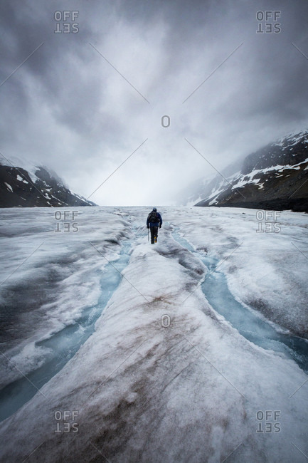 Person hiking on Athabasca glacier in Canada