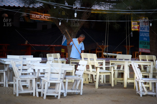 Sam Roi Yot, Thailand - 1/24/16: Man cleaning beach side restaurant