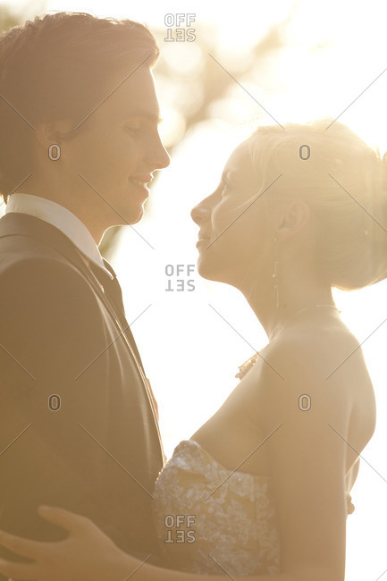Bride and groom in back light