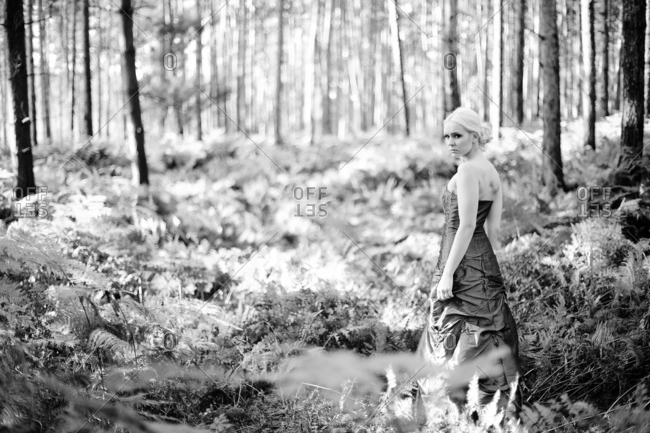 young woman with dress in forest