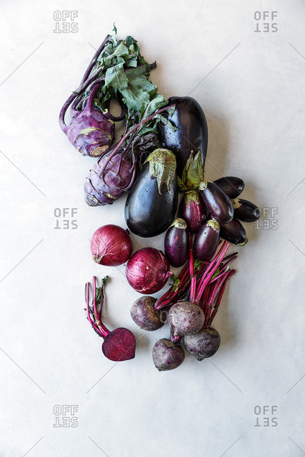Purple vegetables arranged on kitchen table