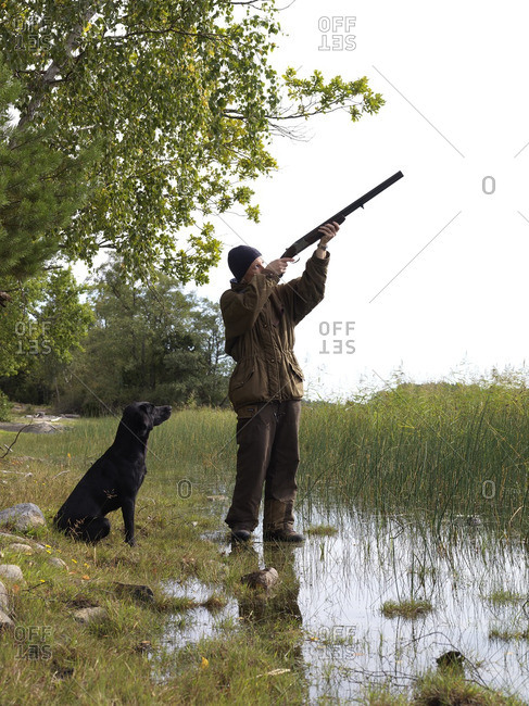Hunter aiming for birds