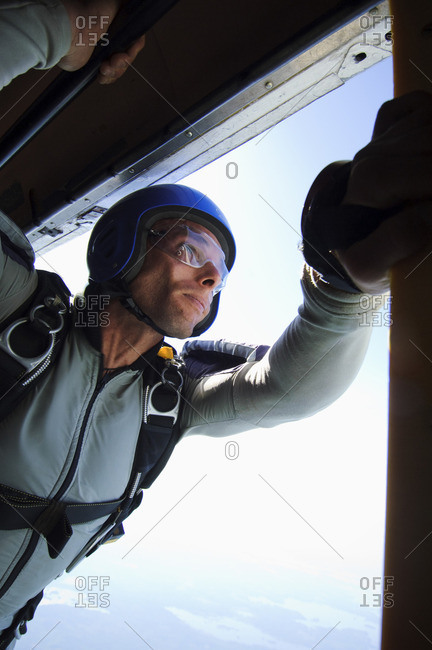 Male skydiver poised to jump