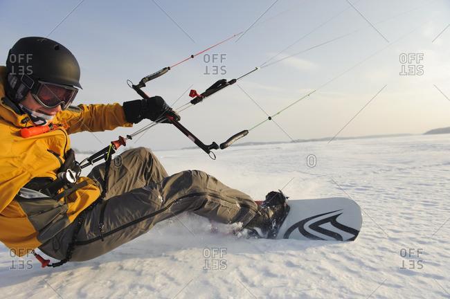 Man kite boarding in snow