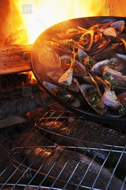 Mussels being grilled