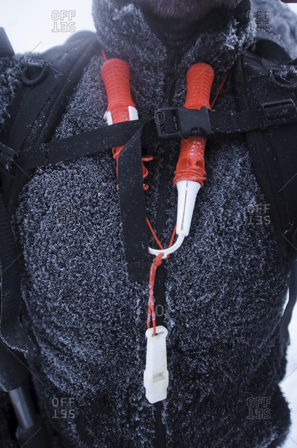 Close-up of climbing equipment on mans chest