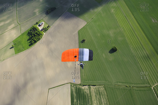 Aerial view of mid adult woman parachuting