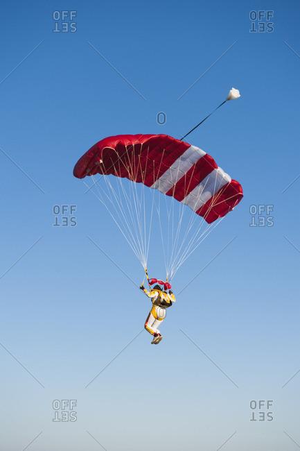 Mid adult woman parachuting