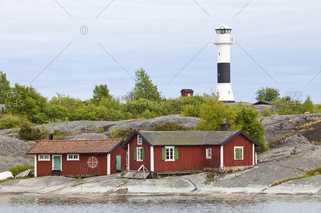 Island with lighthouse and cottage