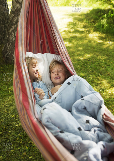 Two girls resting in hammock