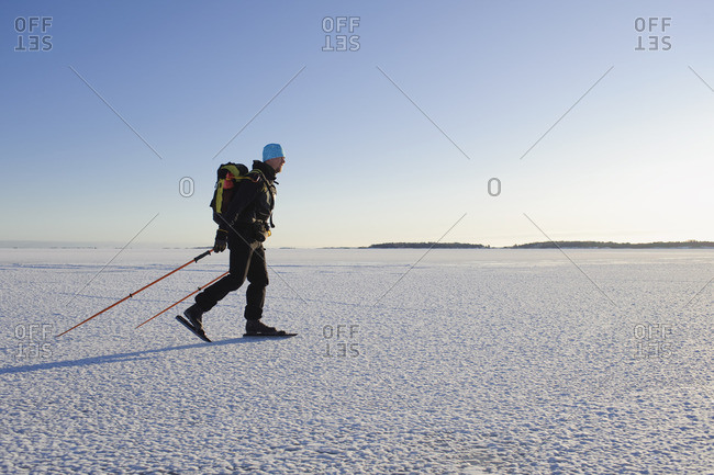 Man ice skating on snow covered landscape