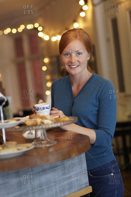 Portrait of smiling woman in cafe
