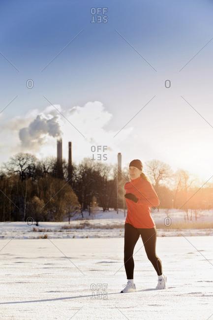 Mature woman jogging in winter