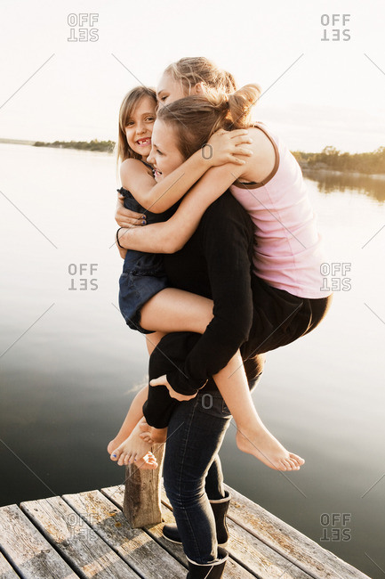 Sisters playing on jetty