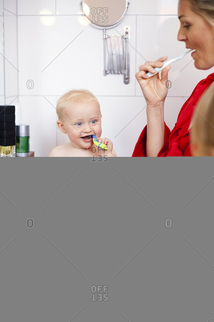 A family brushing their teeth
