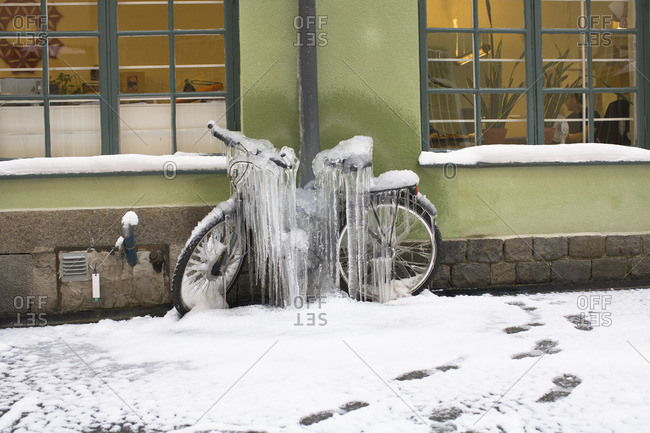 A bicycle covered with ice
