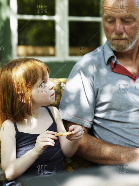 Girl sitting with grandfather