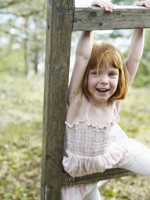 Girl playing on ladder