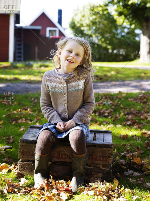 Girl sitting on wooden box