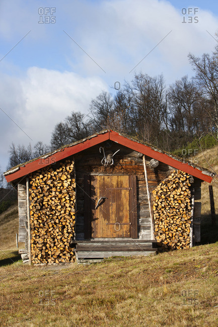 Wooden building with fire logs
