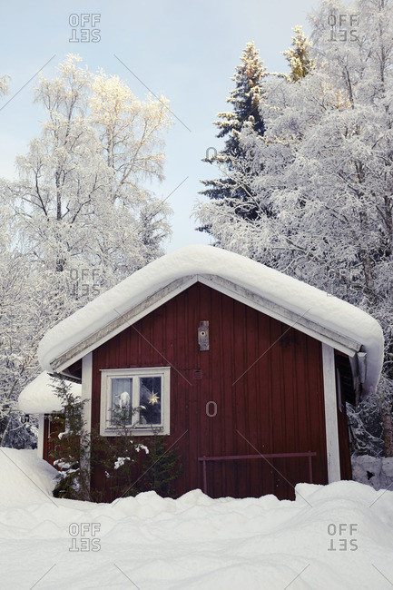 Wooden cottage at winter