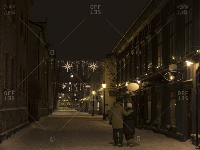 Couple on winter street at night
