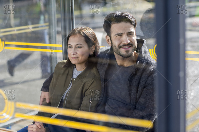 Couple waiting on bus stop