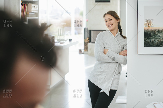Smiling woman in apartment