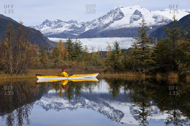 Person In Sea Kayak In A Lake Near Mendenhall Glacier, Tongass National Forest, Juneau, Southeast Alaska, Autumn