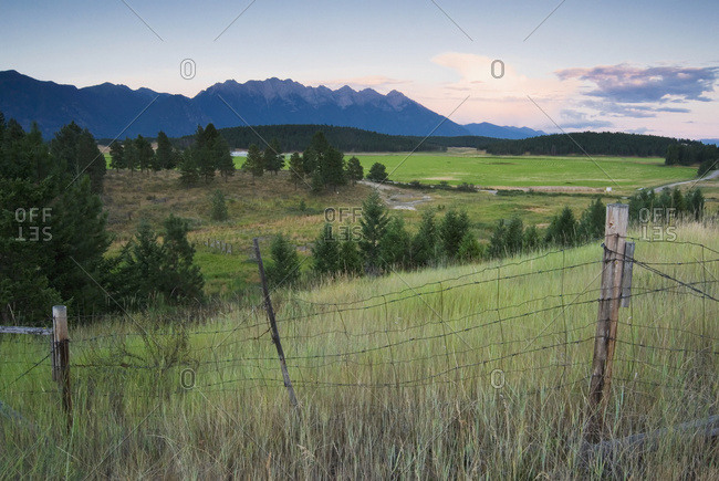 Rural Farmland And Rocky Mountains, Cranbrook, BC, Canada
