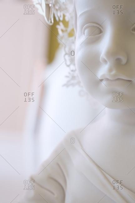 White Figurine Of Child