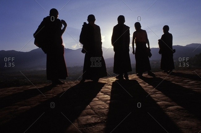 Five Buddhist Monks In Silhouette