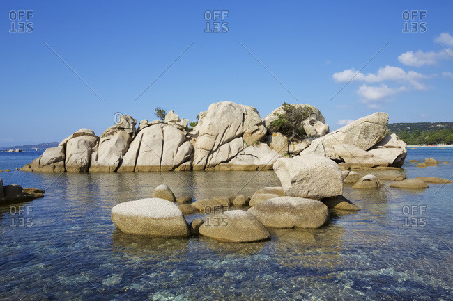 Off-shore rock formations and crystal clear sea water at Palombaggia Tamaricciu beach