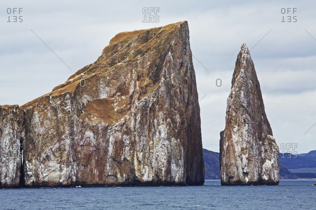 Eroded islet and rock stack at sea in Galapagos