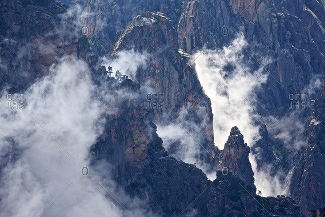 Mist covered jagged peaks of the Alta Rocca mountains