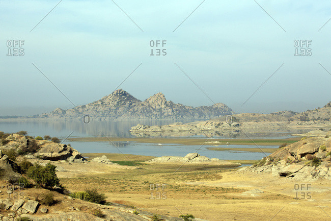 Desert landscape with hills and lake