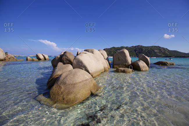 Rock formations in , crystal clear sea of a sandy bay