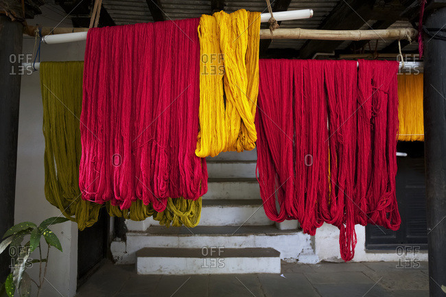 recently dyed thread hanging out to dry at weavers