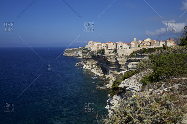Bonifacio citadel perched on dramatic white cliffs overlooking blue sea