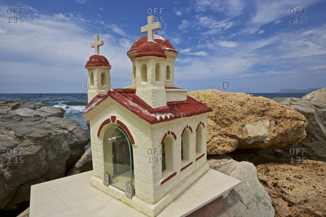 Crete, Greece - August two 5, two 016: Sculpture of a small traditional Greek Orthodox chapel on the seafront