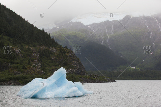 A small iceberg floats in Portage Lake near the Visitor Center and also the road to Whittier, South-central Alaska; Alaska, United States of America